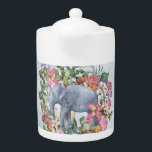 "Elephant in flower jungle 1 teapot<br><div class=""desc"">Illustration of a wonderful elephant in a jungle of tropical flowers on dark grey grunged backround. Designed with Love by UtArt.</div>"