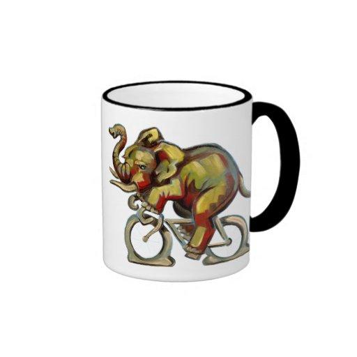 Elephant on a bicycle on a mug