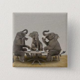 Elephants having tea party button