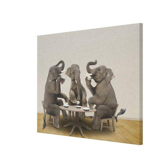 Elephants having tea party canvas print