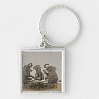 Elephants having tea party keychain
