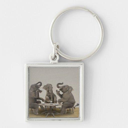 Elephants having tea party keychains