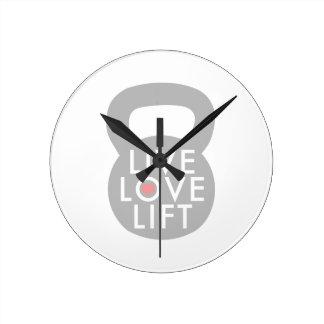 Elevación viva del amor en gris reloj redondo mediano