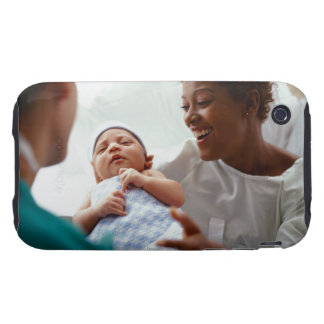 elevated close-up view of a doctor handing a new tough iPhone 3 case