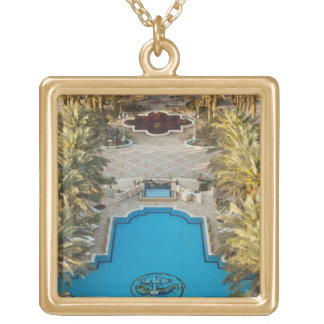 Elevated view Herods Palace Hotel swimming pool Gold Plated Necklace