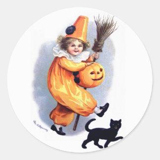 Ellen H. Clapsaddle: Halloween Harlequin with Cat Classic Round Sticker