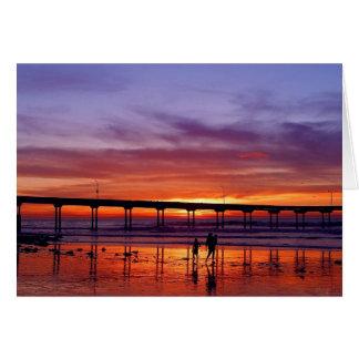 Embarcadero de la puesta del sol tarjeta de felicitación