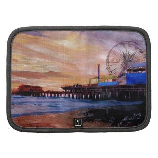 Embarcadero de Santa Mónica en la puesta del sol Planificadores