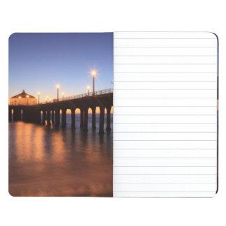 Embarcadero en la puesta del sol, California de Cuadernos