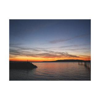 Embarcadero en la puesta del sol impresiones en lienzo estiradas