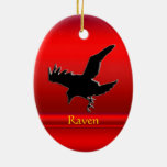 Embossed-look black Raven on red chrome-effect Ornaments