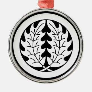 Embracing holly leaves in circle metal ornament