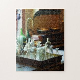 Embudos y botellas de cristal puzzle con fotos