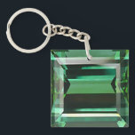 "Emerald 3 keychain<br><div class=""desc"">Square double-sided acrylic keychain with an image,  on both sides,  of a sparkling emerald. See matching large square premium keychain,  button,  charm,  necklace and wrist watch. See the entire Gemstones &amp; Medallions Keychain collection in the ACCESSORIES section.</div>"