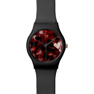 Emoción roja de los corazones del amor verdadero reloj