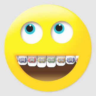 Emoji smiling with colorful braces classic round sticker