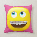 "Emoji with Braces Pillow<br><div class=""desc"">A fun gift for a teen or tween who has braces. A wide-eyed emoji sporting colorful braces is on the front of this pillow. You can change the background color of the pillow front and back to a color of your choice to fit the decor of your own room. &#169;PamJArts...</div>"
