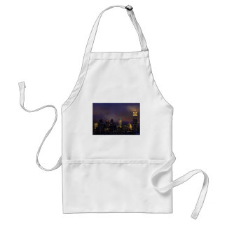 Empire State Building glows in clouds and fog Aprons