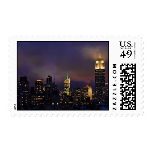 Empire State Building glows in clouds and fog Postage