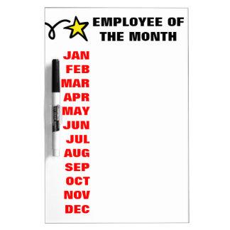 Empleado del tablero seco del borrado del calendar pizarra blanca