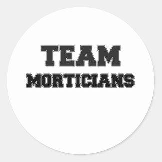Empresarios de pompas fúnebres del equipo etiquetas