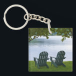 """Empty Adirondack Chairs facing a Lake Keychain<br><div class=""""desc"""">A travel photograph of two empty Adirondack chairs under trees facing a calm lake in the Adirondacks. This photo will make a unique souvenir gift from your New York,  USA  vacation.</div>"""