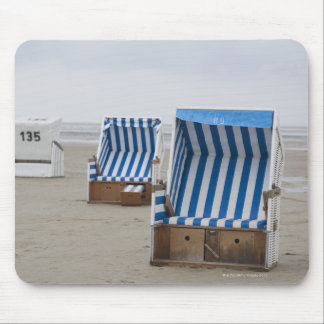 empty beach chairs on beach mouse pad