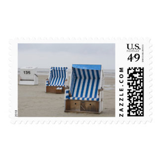 empty beach chairs on beach postage
