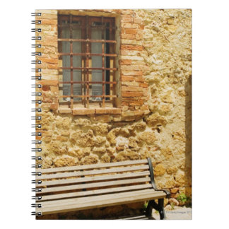 Empty bench in front of a wall, Monteriggioni, Notebook