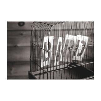 Empty bird cage canvas print