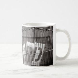 Empty bird cage coffee mug