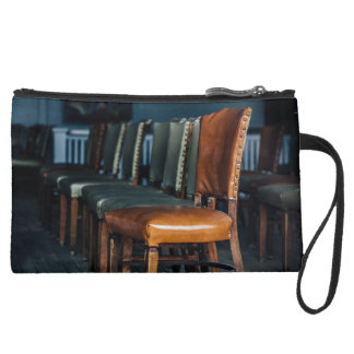 Empty Chairs at the Music Hall Suede Wristlet