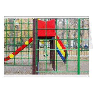 Empty children's playground and a slide card