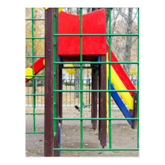 Empty children's playground and a slide postcard