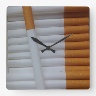 Empty cigarettes grouped together square wall clock