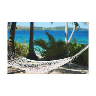 Empty hammock at a tropical beach canvas print