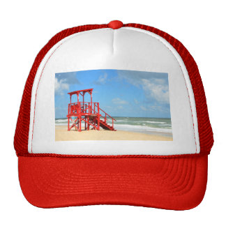 empty lifeguard stand showing lifeguard off duty trucker hat