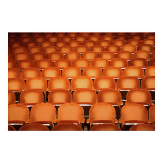 Empty Orange Seats in Auditorium Poster