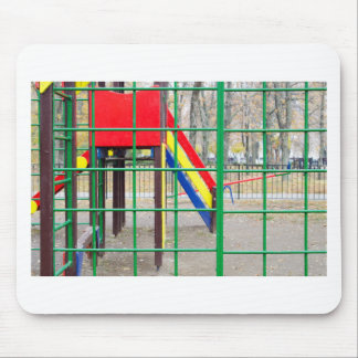 Empty playground in the park against the backdrop mouse pad