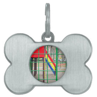 Empty playground in the park against the backdrop pet name tag