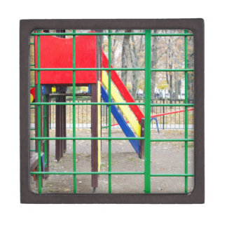 Empty playground in the park against the backdrop premium trinket boxes