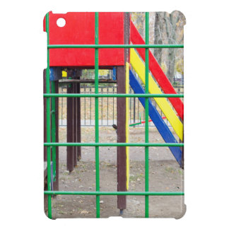 Empty playground in the park with autumn trees iPad mini case