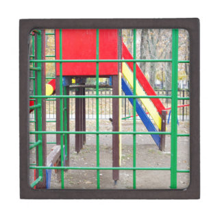 Empty playground in the park with autumn trees premium jewelry boxes
