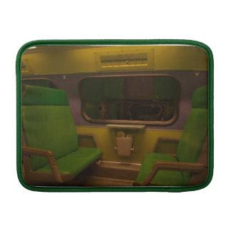Empty Seats on Night Train - green yellow photo MacBook Air Sleeves