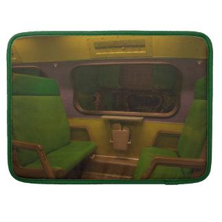 Empty Seats on Night Train - green yellow photo Sleeves For MacBooks