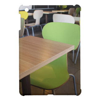 Empty tables and chairs in cafes without visitors iPad mini cover