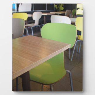 Empty tables and chairs in cafes without visitors plaque