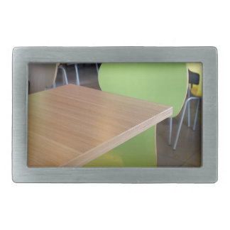 Empty tables and chairs in cafes without visitors rectangular belt buckle
