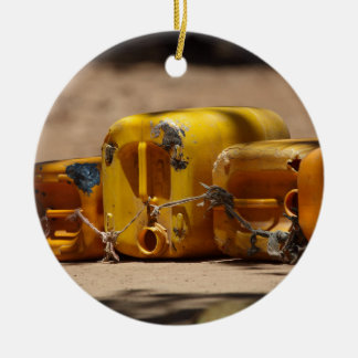 Empty water cans at a well in Africa. Ceramic Ornament