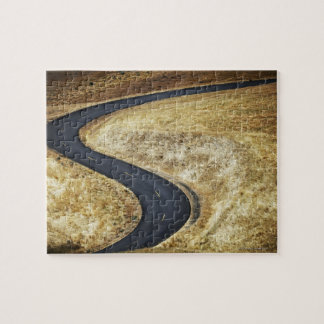 Empty winding paved road jigsaw puzzle